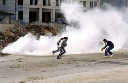 """Teargas"", Abu Ghnaim demonstrations, Ramallah, 26 March 1997. ©1999 Nigel Parry"